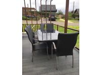 Large Rattan patio table & 8 chairs