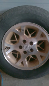 5 Jeep Gold Rims and 225/70R16 Tires.