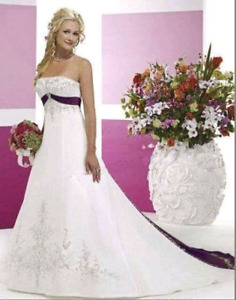Brand new wedding dress.  A-line with purple detail.
