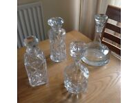 3 cut glass decanters and one heavy ships decanter. All excellent condition