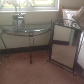 Hall/dining room table and matching mirror.