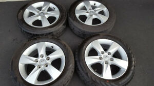 All season tires with rims along with 4 winter tires
