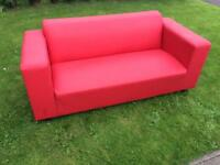 Red faux leather settee