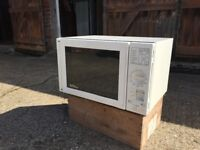 Moulinex free standing microwave oven with various heat settings and timer. Easy to use