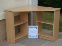 Corner unit. Useful desk with storage for books underneath. Instructions for self-assembly.