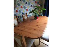 Used Dining table and 4 chairs. Open to sit 8