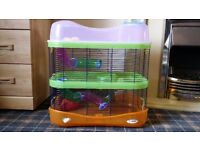 Imac Hamster Fantasy Cage with extension including food bowl, hamster wheel and hamster house.