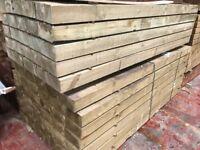 Wooden railway sleepers pressure treated green