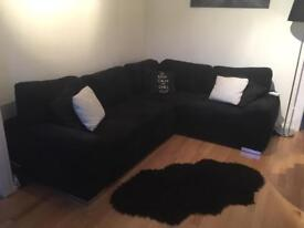 Almost new black corner fabric sofa bed