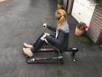 Body sculpture rowing machine