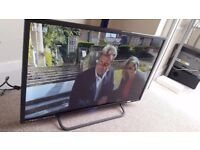 Technika 32G22B-FHD 32 Inch Full HD 1080p Slim LED TV with Freeview HD with JBL speakers
