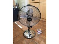 Large electric fan. Free-standing. 3-speed settings. Very effective. Get it while it's hot.