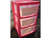 Pink plastic storage drawers