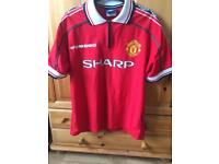 Manchester United's 1998/99 retro football shirt.