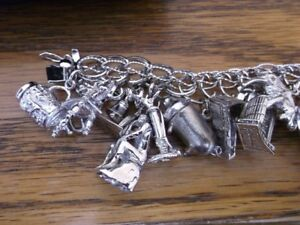 VINTAGE STERLING CHARM BRACELET WITH 29 CHARMS