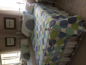 White metal bed with double mattress
