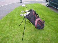 Used golf clubs -- driver, and irons 3-9 -- £25 ono