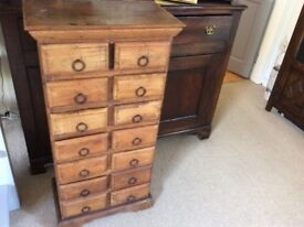 Small wooden cabinet with 14 drawers