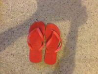 Red Havaianas flip flops