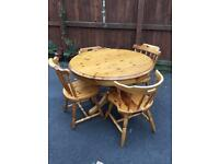 Circular pine table , plus 4 chairs,(2 carvers)