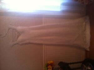 Wedding Dress. Never used. Fits like a small size 6.