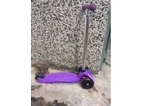 Used Maxi Micro Scooter in Purple. In excellent condition. Suitable for ages 5-12.
