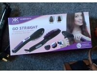 Heated straightening brush