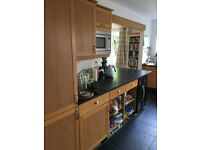 Paula Rosa sold wood oak shaker style kitchen with black granite worktops and appliances