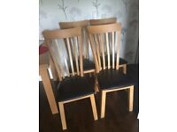 REAL WOOD CHAIRS FOR SALE. VERY GOOD CONDITION. ONLY 4 YEARS OLD. LEATHER SEATS. REAL WOOD CHAIRS
