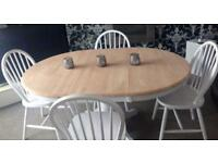 Beautiful extending dining table and 4 chairs