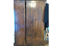 Two wardrobes and a chest of drawers.