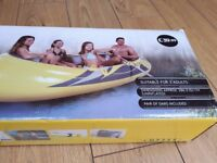 Inflatable boat / dingy with pair of oars. Brand new and boxed