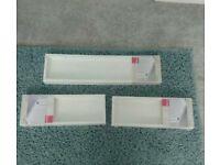 3 White floating storage shelves