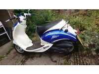 Low mileage - Sym Mio 100 retro looking bike