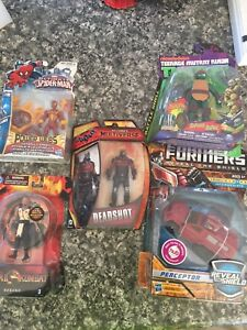 Various action figures new in box.