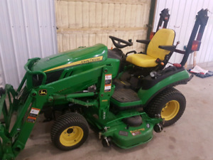 John deere 1026r with attachments.