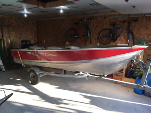 14 ft. Lund boat motor and trailer