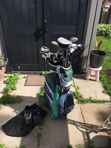 Golf clubs, bag and shoes. Woman's right set of clubs.
