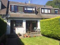 Two bedroom house with garden and garage.