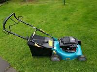 Self propelled lawn mower