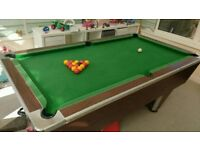Pub style slate pool table with all available playing accessories for sale.