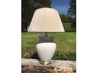 Brand new. Unused cream/ white crackle glaze lamp and silk shade.
