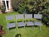 Four folding garden chairs