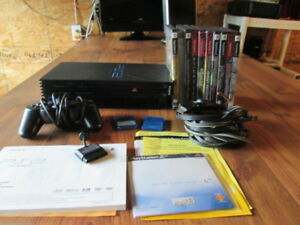 PS2 W/CORDS CONTROLLER 10 GAMES 2 MEMORY CARDS