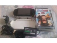 PSP IN GOOD QUALITY WHITE CASE WITH GENUINE CHARGER AND THREE GAMES FOR SALE