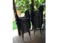 Excellent condition stackable black padded meeting room / office chairs.