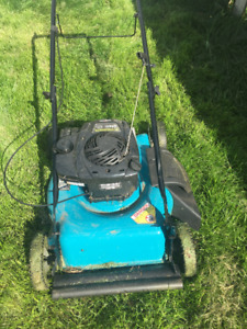 Yard works new gas lawn mower  and Black TRIMMER