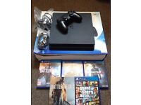 Sony PS4 Slim 500GB - like new, 8 months old & in original box with 4 games.