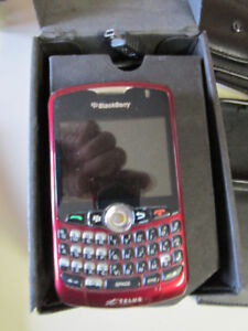 Blackberry Playbook and Blackberry curve phone with accessories