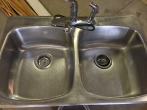 Double stainless steel sink with tap and sprayer